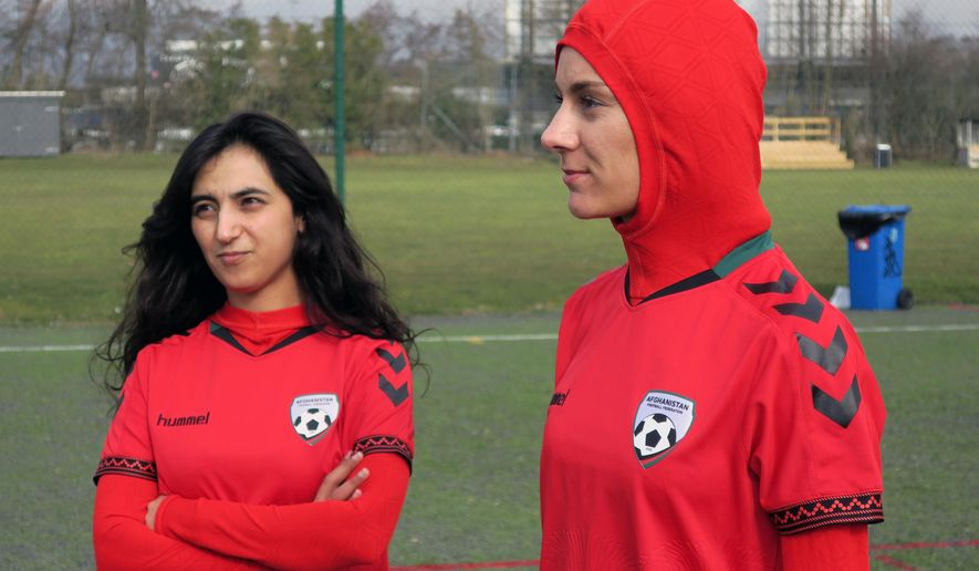 Afghani national soccer team player Shabnam Mabarz, right, wearing the new head-to-toe outfit with an integrated hijab, stands next to Khalida Popal, the former Afghanistan national women's team captain, in Copenhagen on Tuesday, March 8, 2016. The new Afghanistan national women's soccer team uniform was revealed on Tuesday, featuring an integrated hijab. (AP Photos/Jan M. Olsen)