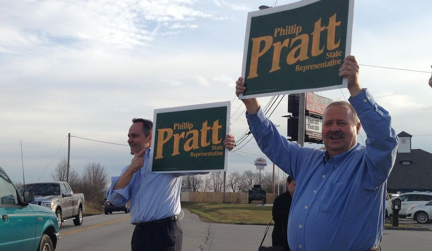 Kentucky Gov. Matt Bevin, left, campaigns with Republican House candidate Phillip Pratt in Georgetown, Ky., Monday, March 7, 2016. Voters on Tuesday are electing four state representatives in a series of special elections created by resignations and two strategic appointments by new Republican Gov. Matt Bevin. (AP Photo/Adam Beam)