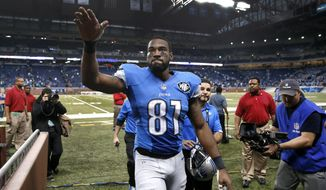 FILE - In this Nov. 9, 2014, file photo, Detroit Lions wide receiver Calvin Johnson waves to fans after defeating the Miami Dolphins 20-16 in a NFL football game in Detroit. Calvin Johnson has retired. The 30-year-old receiver, known as Megatron, announced his decision Tuesday, March 8, 2016, to walk away from the NFL after nine mostly spectacular seasons with the Detroit Lions. (AP Photo/Paul Sancya, File)