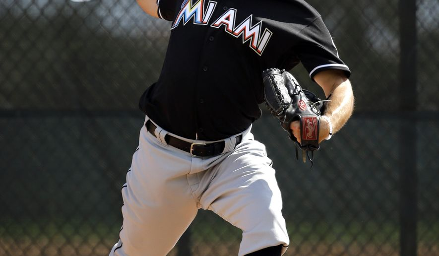 FILE - In this Feb. 22, 2016, file photo, Miami Marlins pitcher Jarred Cosart throws a bullpen session during spring training baseball practice, in Jupiter, Fla. Now that Jarred Cosart has recovered from vertigo, he's part of a crowded field of contenders for two open spots in the Miami Marlins' rotation.  (AP Photo/Jeff Roberson, File)