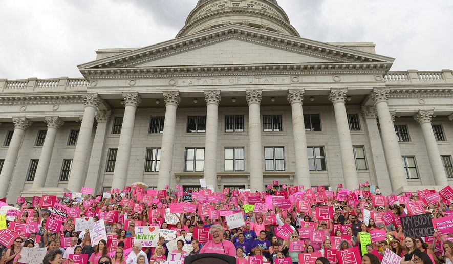 FILE - This Aug. 25, 2015, file photo, Karrie Galloway, CEO of Planned Parenthood Action Council, laughs as the roar of the crowd drowns out her speech at the state Capitol, in Salt Lake City. The Utah branch of Planned Parenthood is set to ask a federal appeals court Tuesday, March 8, 2016,  to reverse a judge's decision that allowed governor to cut off funding to the organization after the release of secretly recorded videos showing out-of-state employees discussing fetal tissue from abortions. (Leah Hogsten/The Salt Lake Tribune via AP, File) DESERET NEWS OUT; LOCAL TELEVISION OUT; MAGS OUT; MANDATORY CREDIT