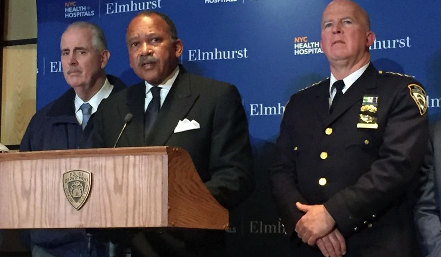 New York Police Department First Deputy Commissioner Benjamin Tucker, at podium, speaks during news conference Tuesday, March 8, 2016, at Elmhurst Hospital in the Queens borough of New York. A New York City police officer was shot by his partner Tuesday night as the two were trying to make an arrest during a drug investigation and two suspects were taken into custody, police say. (AP Photo/Michael Balsamo via AP)