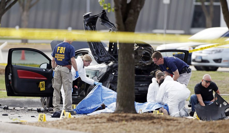 FILE - In this May 4, 2015 file photo, FBI crime scene investigators document the area around two deceased gunmen and their vehicle outside the Curtis Culwell Center in Garland, Texas. A man charged with planning the attack on a Prophet Muhammad cartoon contest took the witness stand Tuesday, March 8, 2016, in his defense, describing how he met the two men who later died in a police shootout outside the controversial event. (AP Photo/Brandon Wade, File)