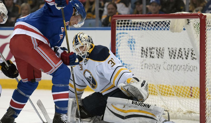 New York Rangers center Eric Staal, left, shoots the puck on Buffalo Sabres goaltender Chad Johnson (31) during the second period of an NHL hockey game, Tuesday, March 8, 2016, in Buffalo, N.Y. (AP Photo/Gary Wiepert)