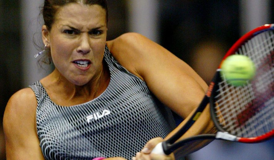 """FILE - In this Nov. 5, 2004 file photo, Jennifer Capriati, of Saddlebrook, Fla., returns to Vera Zvonareva, of Russia, during their Advanta Championship quarterfinal match in Villanova, Pa. On her Twitter account Monday, March 7, 2016, Capriati said she was """"extremely angry and disappointed"""" in Sharapova, who acknowledged testing positive for a recently banned drug. Sharapova claims she had been taking meldonium for 10 years. (AP Photo/Rusty Kennedy, File)"""