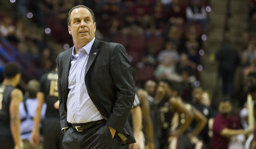 Notre Dame head coach Mike Brey watches in the first half of an NCAA college basketball game against Florida State in Tallahassee, Fla., Saturday, Feb. 27, 2016. (AP Photo/Mark Wallheiser)