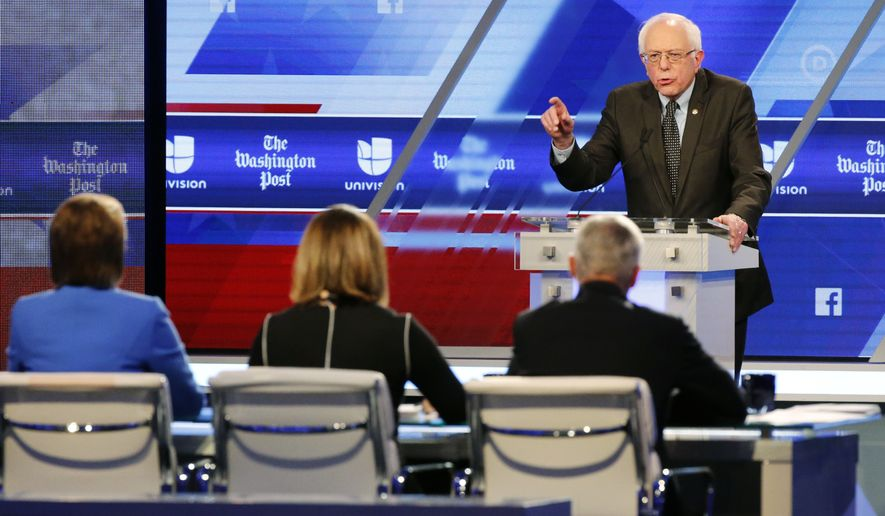 """""""I think that the American people are never going to elect a president who insults Mexicans, who insults Muslims, who insults women, who insults African-Americans,"""" Sen. Bernard Sanders said at a presidential primary debate in Miami. (Associated Press)"""