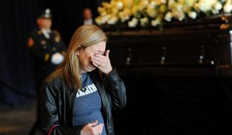 Kimberly Leif, of Simi Valley, Calif., cries in front of the casket of Nancy Reagan at the Ronald Reagan Presidential Library in Simi Valley on Wednesday. (Los Angeles Times via Associated Press)