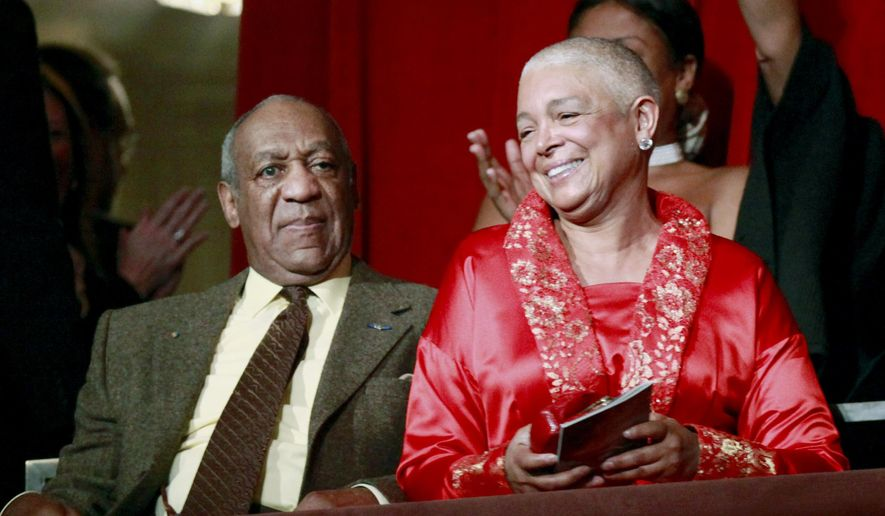 FILE - In this Oct. 26, 2009 file photo, comedian Bill Cosby, left, and his wife Camille appear at the John F. Kennedy Center for Performing Arts before Bill Cosby received the Mark Twain Prize for American Humor in Washington. Camille Cosby, the wife of Bill Cosby said she never read a deposition in which her husband acknowledged he gave sedatives to women he was planning to have sex with, according to an excerpt of her testimony in a defamation lawsuit against her husband. An excerpt of Camille Cosby's deposition was attached to a court filing Monday, March 7, 2016. (AP Photo/Jacquelyn Martin, File)