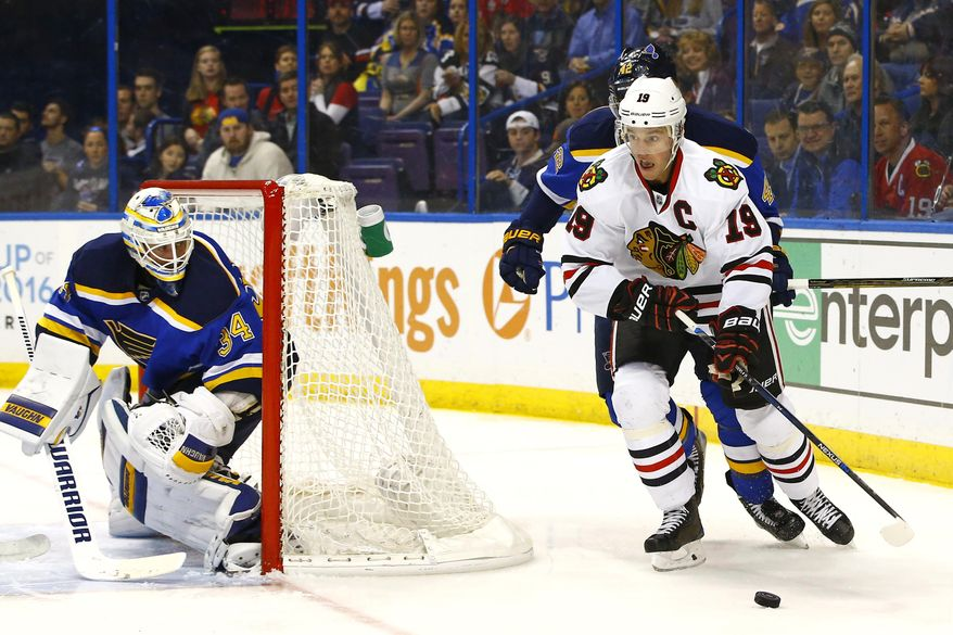 Chicago Blackhawks' Jonathan Toews, right, skates the puck around the net as St. Louis Blues goalie Jake Allen looks over his shoulder during the first period of an NHL hockey game, Wednesday, March 9, 2016, in St. Louis. (AP Photo/Billy Hurst)