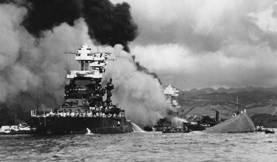In this Dec. 7, 1941 file photo, part of the hull of the capsized USS Oklahoma is seen at right as the battleship USS West Virginia, center, begins to sink after suffering heavy damage, while the USS Maryland, left, is still afloat in Pearl Harbor, Oahu, Hawaii. A sailor killed in the attack on Pearl Harbor is being buried with full military honors nearly 75 years after the bombing. Machinist's Mate 1st Class Vernon Luke of Green Bay, Wisconsin is being buried at a veterans cemetery in Honolulu on Wednesday, March 9, 2016. (U.S. Navy via AP, File)