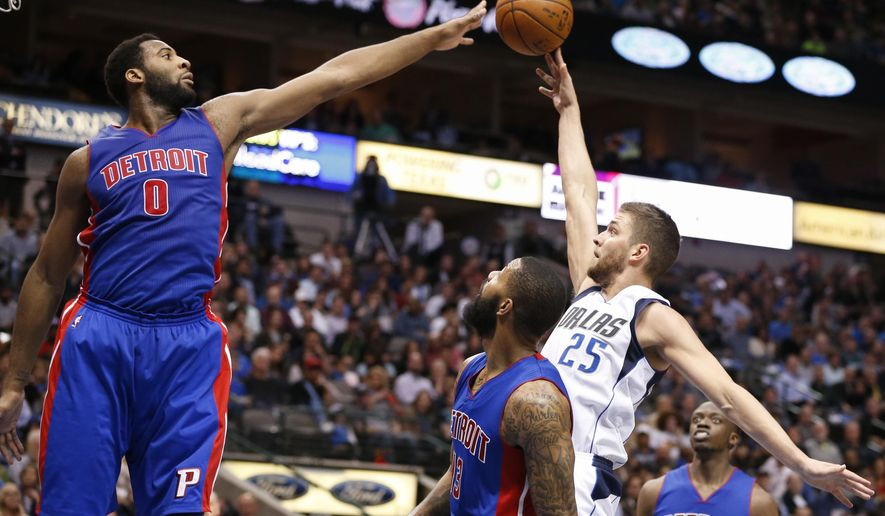Dallas Mavericks forward Chandler Parsons (25) shoots past Detroit Pistons center Andre Drummond (0) and Marcus Morris during the first half of an NBA basketball game, Wednesday, March 9, 2016, in Dallas. (AP Photo/Jim Cowsert)