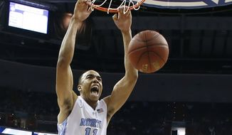North Carolina forward Brice Johnson (11) dunks the ball in front of Pittsburgh forward Jamel Artis (1) during the first half of an NCAA college basketball game in the Atlantic Coast Conference tournament, Thursday, March 10, 2016, in Washington. (AP Photo/Alex Brandon)