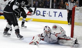 Los Angeles Kings center Jeff Carter (77) reacts after scoring the winning goal against Washington Capitals goalie Braden Holtby, right, during overtime period in an NHL hockey game in Los Angeles, Wednesday, March 9, 2016. The Kings won 4-3. (AP Photo/Alex Gallardo)