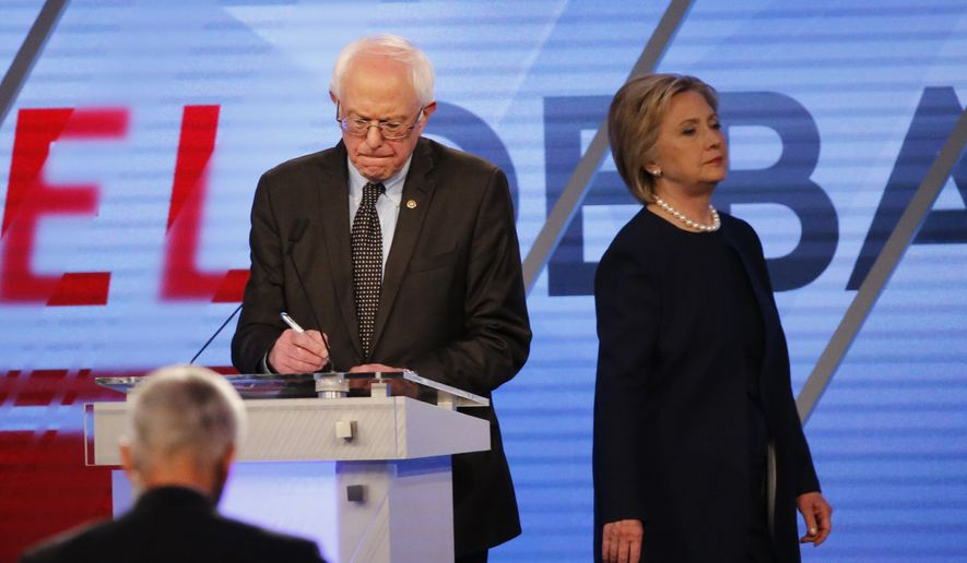 Democratic presidential candidate, Hillary Clinton enters the stage after a break as Democratic presidential candidate, Sen. Bernie Sanders, I-Vt,  makes notes, during the Univision, Washington Post Democratic presidential debate at Miami-Dade College, Wednesday, March 9, 2016, in Miami, Fla. (AP Photo/Wilfredo Lee) ** FILE **