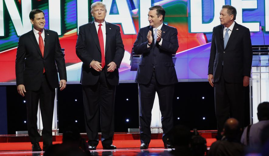 Republican presidential candidates Marco Rubio, Donald Trump, Ted Cruz and John Kasich stand together before the start of the Republican presidential debate sponsored by CNN, Salem Media Group and the Washington Times on Thursday in Coral Gables, Fla. (Associated Press)