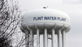 The Flint Water Plant tower is seen in Flint, Mich. (AP Photo/Carlos Osorio, FILE)