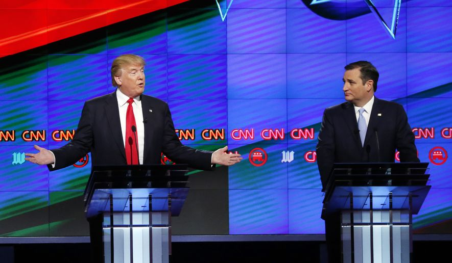 Republican presidential candidate, businessman Donald Trump, left,  answers a question, as Republican presidential candidate, Sen. Ted Cruz, R-Texas,  listens, during the Republican presidential debate sponsored by CNN, Salem Media Group and the Washington Times at the University of Miami,  Thursday, March 10, 2016, in Coral Gables, Fla. (AP Photo/Wilfredo Lee)