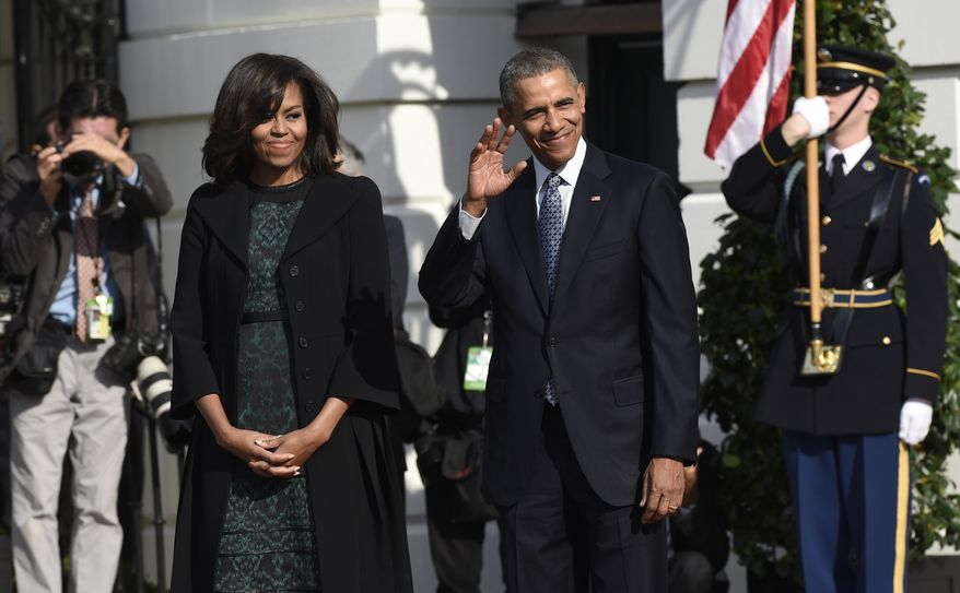 President Barack Obama waves as he waits with first lady Michelle Obama for the arrival of Canadian Prime Minister Justin Trudeau for a state arrival ceremony on the South Lawn of White House in Washington, Thursday, March 10, 2016. (AP Photo/Susan Walsh)