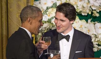 Canadian Prime Minister Justin Trudeau, right, proposes a toast to U.S. President Barack Obama during a state dinner Thursday, March 10, 2016, in Washington. (Paul Chiasson/The Canadian Press via AP) ** FILE **