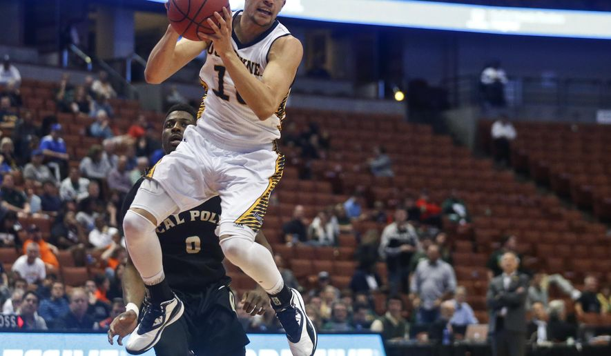 UC Irvine guard Luke Nelson spins to throw an outlet pass during the second half of the team's NCAA college basketball game against Cal Poly at the Big West conference men's tournament Thursday, March 10, 2016, in Anaheim, Calif. Nelson scored 36 points. (AP Photo/Lenny Ignelzi)