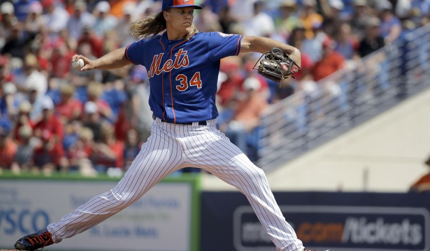 New York Mets starting pitcher Noah Syndergaard throws during the first inning of an exhibition spring training baseball game against the St. Louis Cardinals Thursday, March 10, 2016, in Port St. Lucie, Fla. (AP Photo/Jeff Roberson)