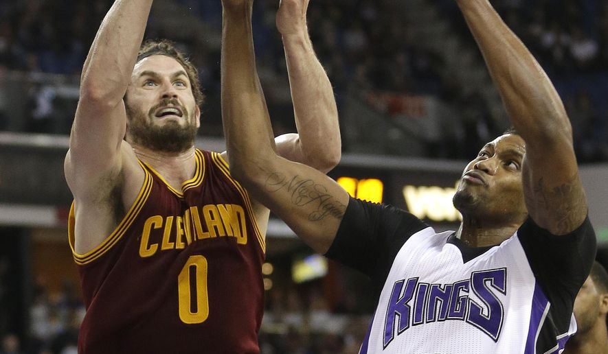Cleveland Cavaliers forward Kevin Love, left, and Sacramento Kings forward Rudy Gay battle for the ball during the first quarter of an NBA basketball game, Wednesday, March 9, 2016, in Sacramento, Calif. (AP Photo/Rich Pedroncelli)