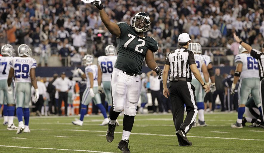 FILE - In this Dec. 29, 2013 file photo, Philadelphia Eagles defensive end Cedric Thornton (72) celebrates after cornerback Brandon Boykin intercepted the ball from Dallas Cowboys quarterback Kyle Orton during the second half of an NFL football game, in Arlington, Texas. The Cowboys have agreed on a four-year contract with former Philadelphia defensive lineman Thornton. The deal reported on the team's website Thursday, March 10, 2016, came a day after middle linebacker Rolando McClain rejoined a defense looking for more impact plays after struggling to help the team during a 4-12 season played mostly without injured quarterback Tony Romo. (AP Photo/Tony Gutierrez, File)