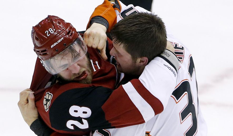 FILE - In this March 3, 2016, file photo, Anaheim Ducks' Nick Ritchie, right, fights with Arizona Coyotes' Jarred Tinordi (28) during the third period of an NHL hockey game in Glendale, Ariz. Tinordi has been suspended for 20 games without pay for violating terms of the NHL's performance-enhancing substances program. The NHL announced the suspension Wednesday, March 9, 2016. (AP Photo/Ross D. Franklin, File)