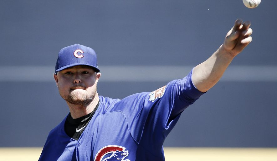 Chicago Cubs starting pitcher Jon Lester throws during the first inning of a spring training baseball game against the Seattle Mariners Thursday, March 10, 2016, in Peoria, Ariz. (AP Photo/Charlie Riedel)