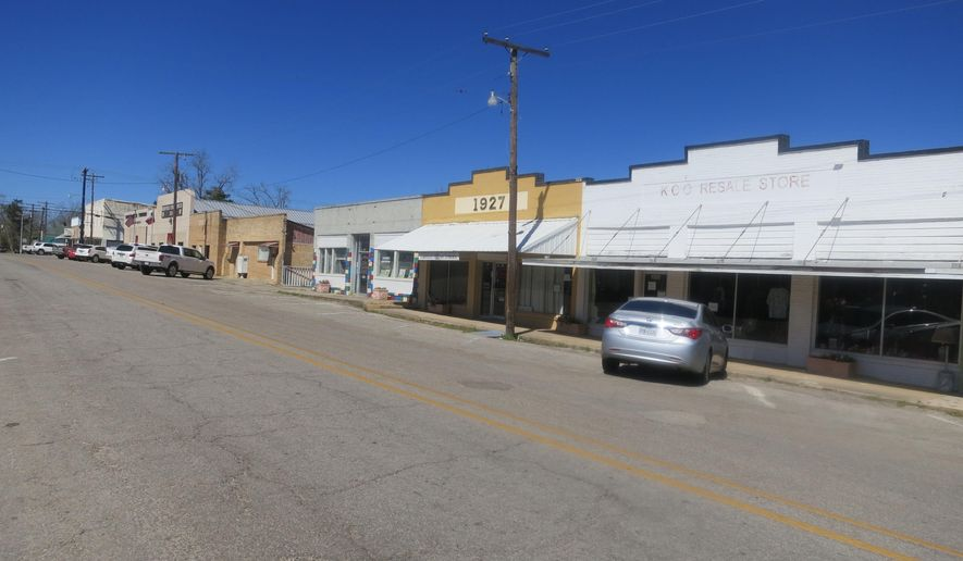 ADVANCE FOR WEEKEND EDITIONS MARCH 12-13 - This March 2, 2016 photo shows downtown Kirbyville, Texas. John Henry Kirby, the prototypical East Texas timber baron, made a whale of a lot of money in the dense Piney Woods that once surrounded this little East Texas town that bears his name. (Joe Holley/Houston Chronicle via AP) MANDATORY CREDIT