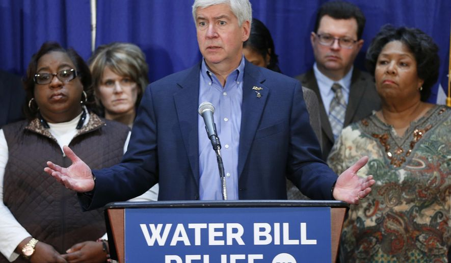 FILE - In this Feb. 26, 2016 file photo, Gov. Rick Snyder speaks after attending a Flint Water Interagency Coordinating Committee meeting in Flint, Mich. Gov. Snyder on Thursday, March 10, released another 4,400 pages of his executive office's emails and documents related to the lead-contaminated water in Flint. The disclosure is the third voluntary release of such records, which have revealed his administration's inner dialogue before the crisis and as it grew after the financially struggling city left Detroit's water system and started using the Flint River to save money. (AP Photo/Paul Sancya, File)