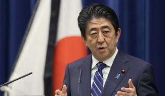 Japanese Prime Minister Shinzo Abe speaks to the media during a press conference at his official residence in Tokyo, Thursday, March 10, 2016, on the eve of the fifth anniversary of the March 11, 2011, earthquake and tsunami. (AP Photo/Shizuo Kambayashi)