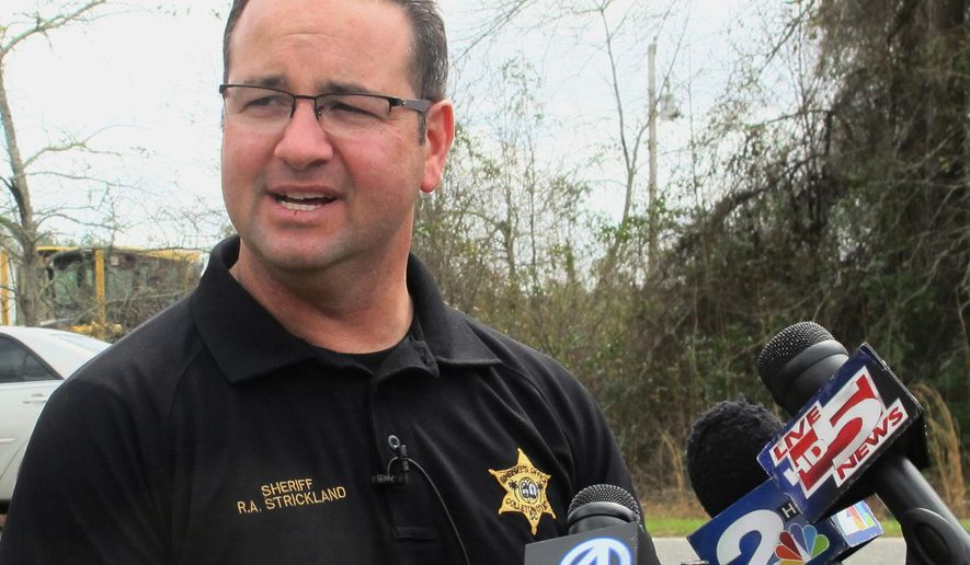 Colleton County Sheriff R.A. Strickland talks with members of the media about the search for multiple missing children on Thursday, March 10, 2016, near the community of Smoaks, S.C. Strickland announced that the children were found in an abandoned house near their home. (AP Photo/Bruce Smith)