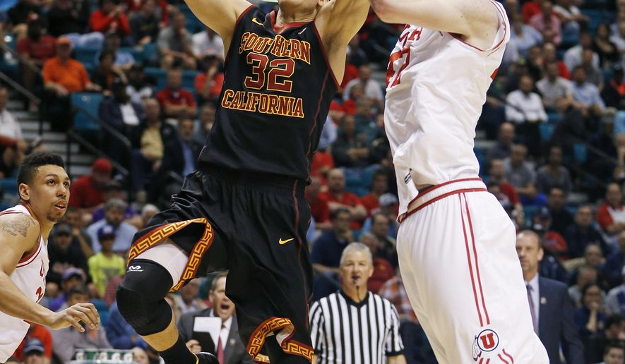 Southern California forward Nikola Jovanovic shoots around Utah forward Jakob Poeltl during the first half of an NCAA college basketball game in the quarterfinal round of the Pac-12 men's tournament Thursday, March 10, 2016, in Las Vegas. (AP Photo/John Locher)