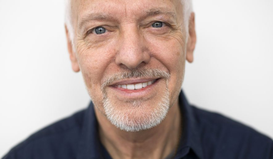 """In this Feb. 25, 2016 photo, musician Peter Frampton poses for a portrait in New York.  The English-born Frampton, now 65, released, """"Acoustic Classics,"""" a CD of stripped-down versions of his best-known songs, in February. (Photo by Scott Gries/Invision/AP)"""