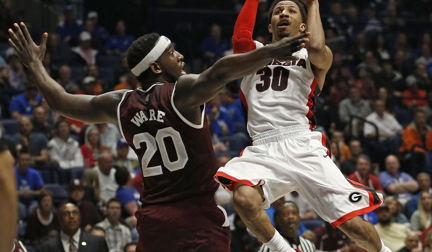 Georgia's J.J. Frazier (30) shoots over Mississippi State's Gavin Ware (20) during the first half of an NCAA college basketball game in the Southeastern Conference tournament in Nashville, Tenn., Thursday, March 10, 2016. (AP Photo/John Bazemore)