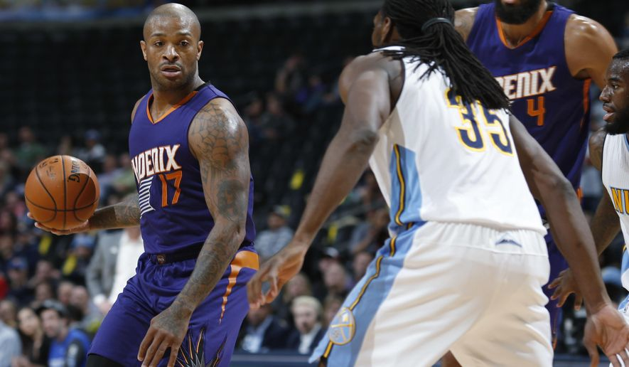 Phoenix Suns forward P.J. Tucker, left, pulls in a loose ball as Denver Nuggets forward Kenneth Faried defends in the first half of an NBA basketball game Thursday, March 10, 2016, in Denver. (AP Photo/David Zalubowski)