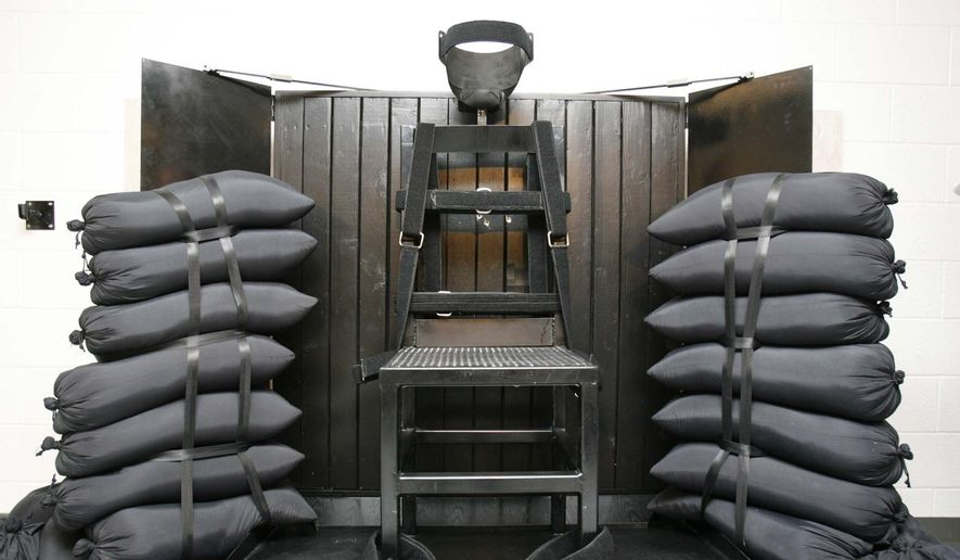 This June 18, 2010, file photo shows the firing squad execution chamber at the Utah State Prison, in Draper, Utah. Lawmakers in South Carolina are debating instituting death by firing squad as an execution method. (Trent Nelson/Salt Lake Tribune via AP, Pool, File) **FILE**