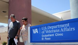 A couple exits the Veterans Affairs facility in El Paso, Texas, on June 9, 2014. (Associated Press) **FILE**