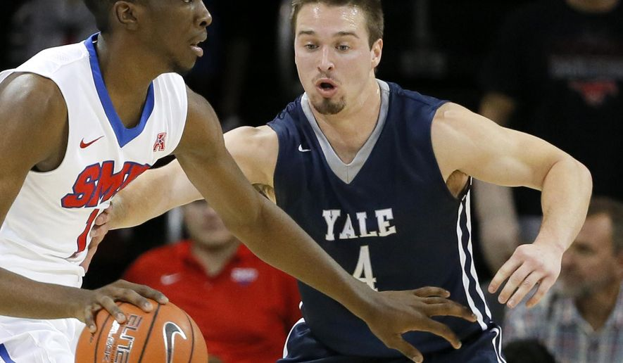 In this Nov. 22, 2015, photo, Yale's Jack Montague, right, defends against SMU guard Shake Milton during an NCAA college basketball game in Dallas. Yale announced on Feb. 24, 2016, that Montague was no longer on the team. Citing federal privacy law, Yale declined to give details and confirmed only that Montague is no longer a student. Montague's father has said he was expelled from the school in February. (AP Photo/Tony Gutierrez)