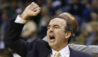 FILE - In this March 17, 2015, file photo, George Washington head coach Mike Lonergan gestures during an NCAA college basketball game against Pittsburgh, in Pittsburgh. At this time of year college basketball coaches often sound like political candidates looking for votes as they tout their teams' NCAA tournament worthiness. (AP Photo/Keith Srakocic, File) **FILE**