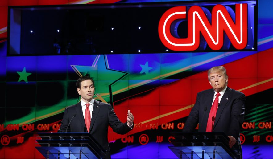 Republican presidential candidate, Sen. Marco Rubio, R-Fla., speaks, as Republican presidential candidate, businessman Donald Trump, listens, during the Republican presidential debate sponsored by CNN, Salem Media Group and the Washington Times at the University of Miami,  Thursday, March 10, 2016, in Coral Gables, Fla. (AP Photo/Wilfredo Lee)