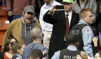 Chicago police start to clear the crowd after a rally for Republican presidential candidate Donald Trump was canceled on the campus of the University of Illinois-Chicago, Friday, March 11, 2016, in Chicago. (AP Photo/Charles Rex Arbogast)