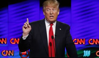 Republican presidential candidate Donald Trump speaks during the Republican presidential debate sponsored by CNN, Salem Media Group and The Washington Times at the University of Miami in Coral Gables, Fla., on March 10, 2016. (Associated Press) **FILE**