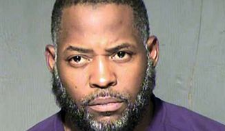 FILE - This undated law enforcement file booking photo provided by the Maricopa County, Ariz., Sheriff's Department shows Abdul Malik Abdul Kareem. Attorneys are scheduled to make closing arguments Friday, March 11, 2016, at the trial of an Arizona man charged with plotting an attack at a Prophet Muhammad cartoon contest in Texas. Kareem is accused of providing the guns used in the May 2015, attack in a Dallas suburb.  (Maricopa County Sheriff's Department via AP, File)