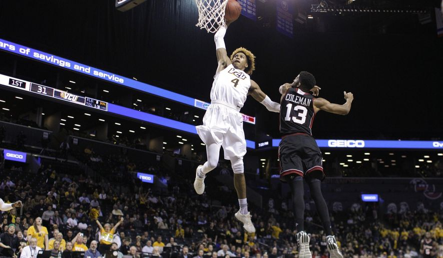 Virginia Commonwealth's Justin Tillman (4) dunks the ball in front of Massachusetts's Zach Coleman (13) during the first half of an NCAA college basketball game during the Atlantic 10 men's tournament Friday, March 11, 2016, in New York. (AP Photo/Frank Franklin II)