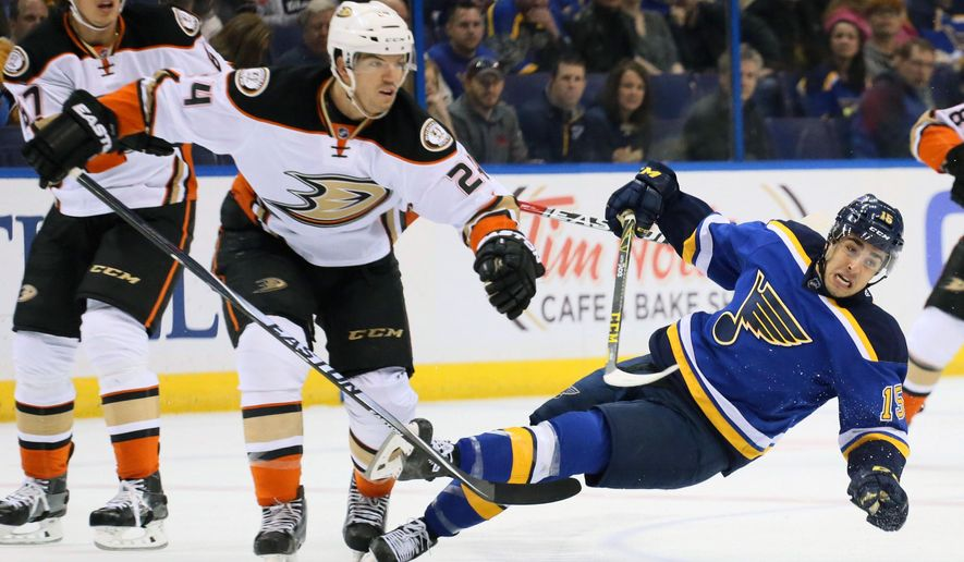 St. Louis Blues center Robby Fabbri, right, is knocked down by Anaheim Ducks defenseman Simon Despres in the first period during of an NHL hockey game Friday, March 11, 2016, in St. Louis. (Chris Lee/St. Louis Post-Dispatch via AP)  EDWARDSVILLE INTELLIGENCER OUT; THE ALTON TELEGRAPH OUT; MANDATORY CREDIT