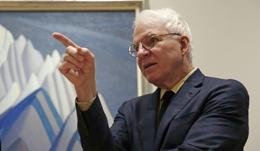 "Actor and comedian Steve Martin, who is guest curator of an exhibition at the Museum of Fine Arts devoted to Canadian modernist Lawren Harris, gestures while discussing Harris's work during a gathering at the museum in Boston, Friday, March 11, 2016. ""The Idea of North: The Paintings of Lawren Harris"" runs through June 12. (AP Photo/Charles Krupa)"
