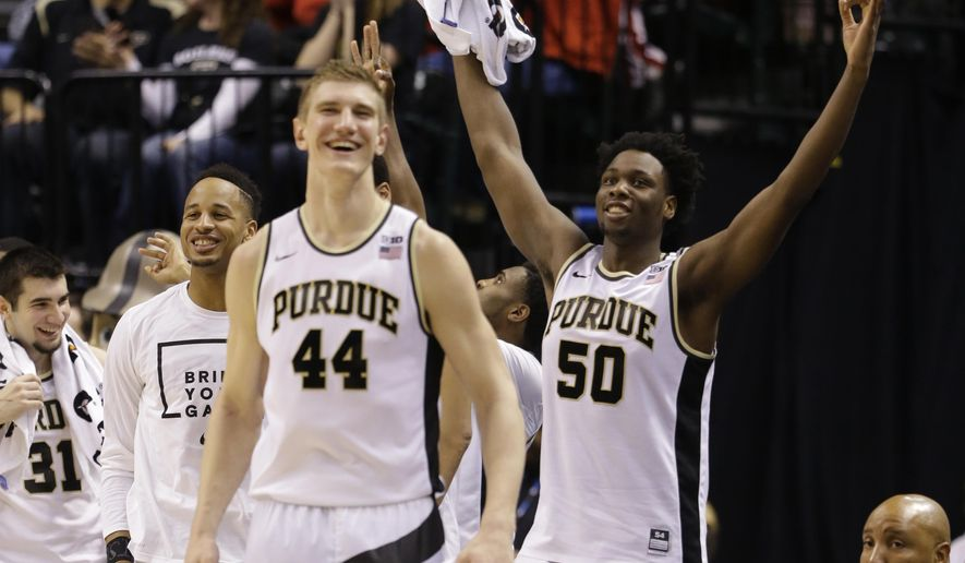 Purdue's Isaac Haas (44) and Caleb Swanigan (50) celebrates a three point basket from the bench during the second half of an NCAA college basketball game against the Illinois in the quarterfinals at the Big Ten Conference tournament, Friday, March 11, 2016, in Indianapolis. Purdue won 89-58. (AP Photo/Michael Conroy)